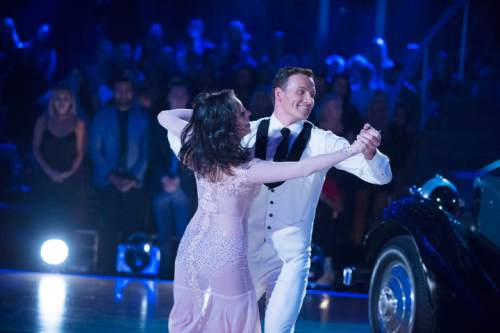 "In this photo provided by ABC, Cheryl Burke, left, and Ryan Lochte, perform on ""Dancing with the Stars,"" competition that begins with the two-hour season premiere live, Monday, Sept. 12, 2016, on the ABC Television Network. (Eric McCandless/ABC via AP)"
