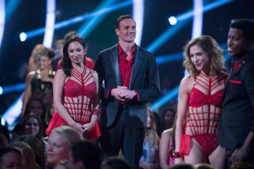 "In this photo provided by ABC, Cheryl Burke, left, and Ryan Lochte, center, appear on ""Dancing with the Stars,"" competition that begins with the two-hour season premiere live, Monday, Sept. 12, 2016, on the ABC Television Network. (Eric McCandless/ABC via AP)"