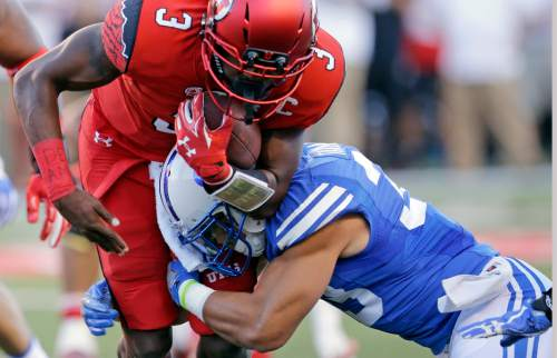 BYU defensive back Eric Takenaka, right, tackles Utah quarterback Troy Williams (3) in the first half of an NCAA college football game Saturday, Sept. 10, 2016, in Salt Lake City. (AP Photo/Rick Bowmer)