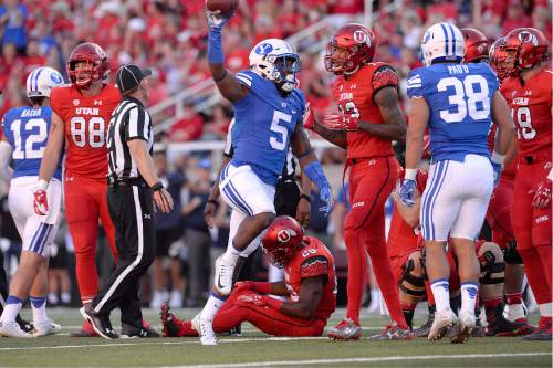 Scott Sommerdorf   |  The Salt Lake Tribune   BYU DB Dayan Lake leaps up with a fumble recovered from Utah RB Joe Williams during first half play. Utah led BYU 7-6 after one quarter of play, Saturday, September 10, 2016.