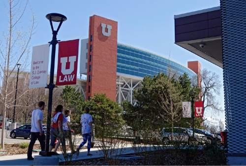 Lennie Mahler  |  Tribune file photo University of Utah students walk around campus in April.