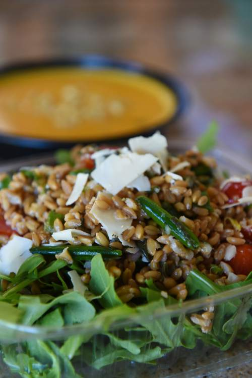Francisco Kjolseth | The Salt Lake Tribune  Utah entrepreneurs have jumped on the trend of meal delivery. Local chef Page Ane Viehweg, who started Wasatch Fresh in June, assembles a vegetarian farro and pea salad on arugula along with a curry, ginger and carrot soup.