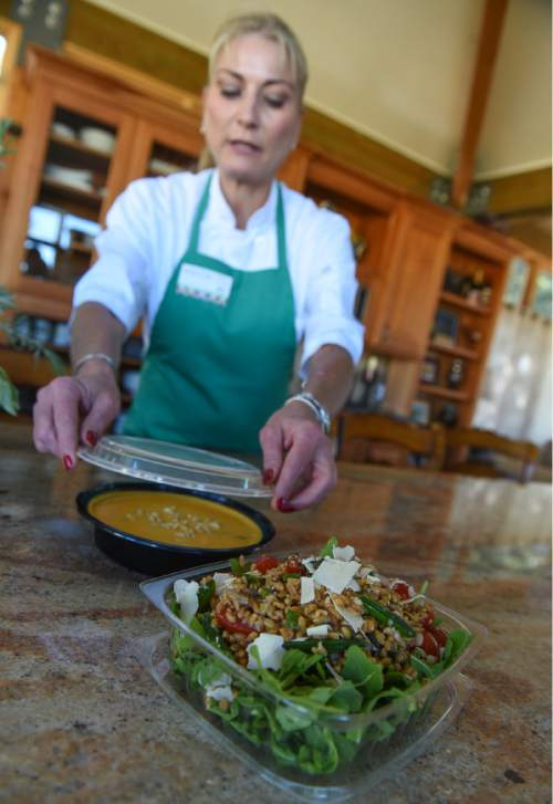 Francisco Kjolseth | The Salt Lake Tribune A few Utah entrepreneurs have jumped on the trend of meal delivery. Local chef, Page Ane Viehweg, who started Wasatch Fresh in June, assembles a vegetarian farro and pea salad on arugula along with a curry, ginger and carrot soup.