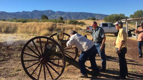 |  Courtesy Sonny Dyle  Robert Kirby cranks off a few rounds from a Colt Gatling gun while the gun's owner, Ray L. Howser, center, supervises in Fillmore on Saturday, Sept. 10, 2016.