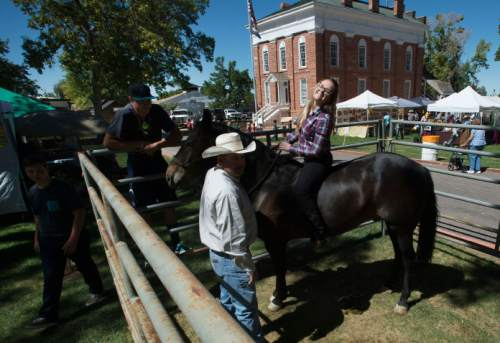 Steve Griffin / The Salt Lake Tribune   Students from the Equine Science program at Millard High School sit on horses on display at the Arts & Living History Festival at the Territorial Statehouse Park in Fillmore, Utah, Friday September 9, 2016.