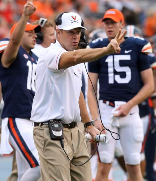 FILE - In this Sept. 3, 2016, file photo, new Virginia head coach Bronco Mendenhall calls for a two-point conversion during the second half of an NCAA college football game in Charlottesville, Va. Mendenhall is urging patience as the Cavaliers are rebuilt. After a disappointing season-opening loss to lower-tier Richmond, the Cavaliers make the 2,800-mile trip to Eugene, Ore., to face No. 24 Oregon on Saturday, Sept. 10, 2016. (AP Photo/Andrew Shurtleff, File)