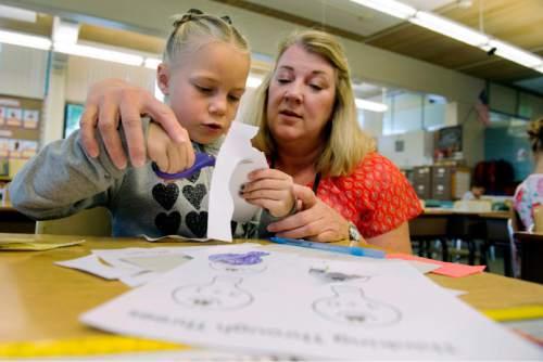 Steve Griffin / The Salt Lake Tribune   First grade teacher Heidi Baer helps Tenley Wilson with scissors during class at Howard Driggs Elementary in Holladay Thursday September 15, 2016.
