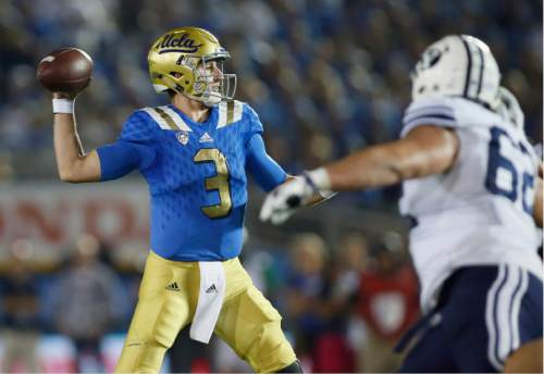 UCLA quarterback Josh Rosen looks to pass against BYU during the first half of an NCAA college football game, Saturday, Sept. 19, 2015, in Pasadena, Calif. (AP Photo/Danny Moloshok)