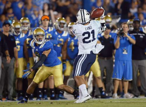 BYU linebacker Harvey Langi, right, intercepts a pass intended for UCLA wide receiver Jordan Payton during the first half of an NCAA college football game, Saturday, Sept. 19, 2015, in Pasadena, Calif. (AP Photo/Danny Moloshok)