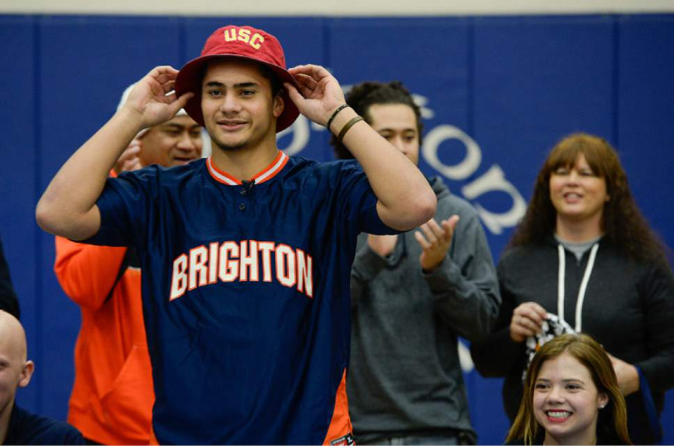 Francisco Kjolseth     The Salt Lake Tribune  Brighton's five-star linebacker Osa Masina, regarded as the top-rated college prospect coming out of Utah, picks up the USC hat as he reveals his school of choice to attend and play during a school assembly held in his honor and other student athletes receiving school scholarships.
