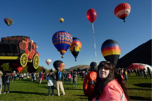 Scott Sommerdorf   |  The Salt Lake Tribune   Jaci Webb watches as the balloons ascend at the Autumn Aloft Hot Air Balloon Festival returns for its third flight at the North 40 Fields in Park City, Saturday, September 17, 2016.