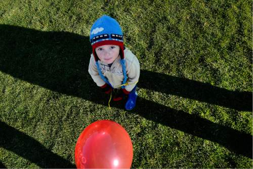 Scott Sommerdorf   |  The Salt Lake Tribune   Three year old Eli Lusvy watches the balloons ascend at the Autumn Aloft Hot Air Balloon Festival returns for its third flight at the North 40 Fields in Park City, Saturday, September 17, 2016.