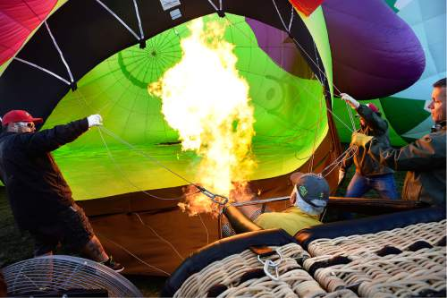 Scott Sommerdorf   |  The Salt Lake Tribune   Bill Gaskill and other members of the ground crew for the Owl balloon get it inflated at the Autumn Aloft Hot Air Balloon Festival returns for its third flight at the North 40 Fields in Park City, Saturday, September 17, 2016.