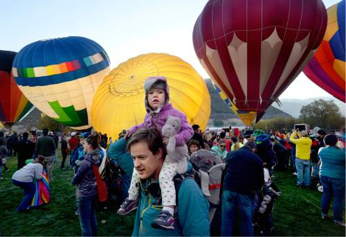 Scott Sommerdorf   |  The Salt Lake Tribune   Bryan Markkanen holds his daughter Nora as the Autumn Aloft Hot Air Balloon Festival returns for its third flight at the North 40 Fields in Park City, Saturday, September 17, 2016.
