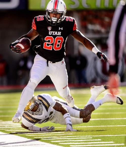 Trent Nelson  |  The Salt Lake Tribune Utah Utes running back Joe Williams (28) is chased out of bounds by a UCLA defender as the University of Utah hosts UCLA, NCAA football at Rice-Eccles Stadium in Salt Lake City, Saturday November 21, 2015.