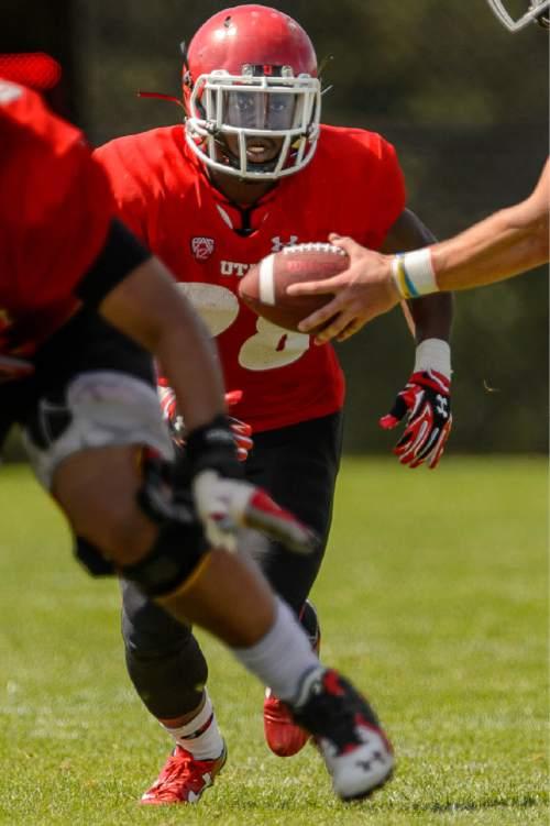 Trent Nelson  |  The Salt Lake Tribune University of Utah running back Joe Williams runs the ball at football practice in Salt Lake City, Tuesday August 11, 2015.