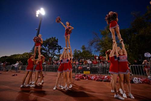 East Leopards cheerleaders cheer from the sideline against the De La Salle Spartans in the first quarter of their game at De La Salle High School in Concord, Calif., on Friday, Sept. 16, 2016. (Jose Carlos Fajardo/Bay Area News Group)