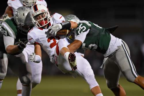 East Leopards' Charlie Vincent (21) is tackled by De La Salle Spartans' Kairee Robinson (25) in the second quarter of their game at De La Salle High School in Concord, Calif., on Friday, Sept. 16, 2016. (Jose Carlos Fajardo/Bay Area News Group)