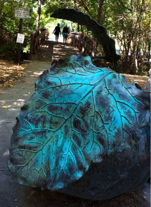 Steve Griffin / The Salt Lake Tribune   A giant bronze sugar beet in the Hidden Hollow area of Sugarhouse is visible to those who walk along the trails in the are of Salt Lake City Friday September 16, 2016.  Four of the bronze beets, by artist Dau Christensen, were commissioned by the Redevelopment Agency of Salt Lake City for the Sugar House Business District in 2003.