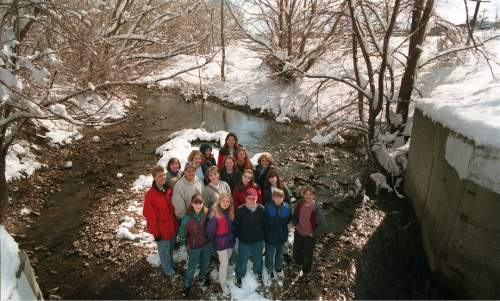 Tribune file photo   Students involved in the Hidden Hollow project are seen at Hidden Hollow in Sugarhouse in this photo from 1998.