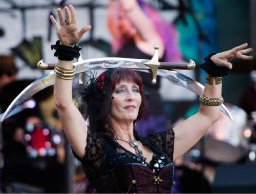 Rick Egan  |  The Salt Lake Tribune  Melody Bustillos, dances with swords as  Juana Ghani plays the Gallivan Street stage, at the Urban Arts Festival at the Gallivan Center, Sunday, September 18, 2016. The free two-day event is a celebration of urban and artistic culture for the community. The festival features art, music, dance, film, live street art demonstrations, automotive arts and computer arts.