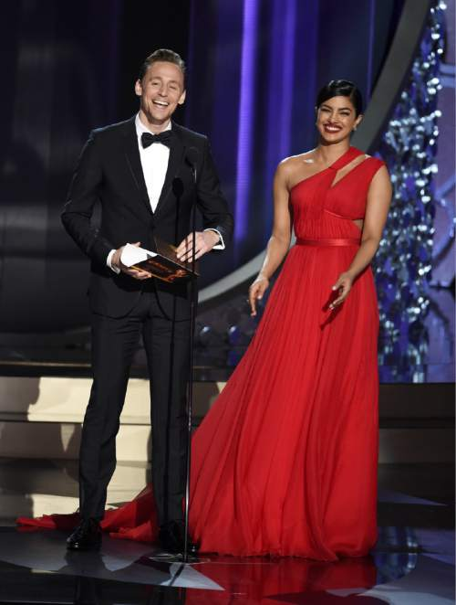 Tom Hiddleston, left, and Priyanka Chopra present an award at the 68th Primetime Emmy Awards on Sunday, Sept. 18, 2016, at the Microsoft Theater in Los Angeles. (Photo by Chris Pizzello/Invision/AP)
