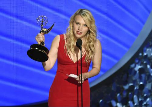 """Kate McKinnon accepts the award for outstanding supporting actress in a comedy series for """"Saturday Night Live"""" at the 68th Primetime Emmy Awards on Sunday, Sept. 18, 2016, at the Microsoft Theater in Los Angeles. (Photo by Chris Pizzello/Invision/AP)"""
