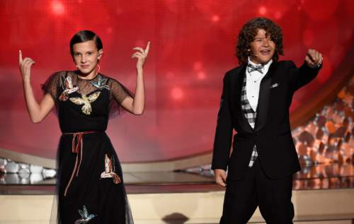 Millie Bobby Brown, left, and Gaten Matarazzo perform at the 68th Primetime Emmy Awards on Sunday, Sept. 18, 2016, at the Microsoft Theater in Los Angeles. (Photo by Chris Pizzello/Invision/AP)