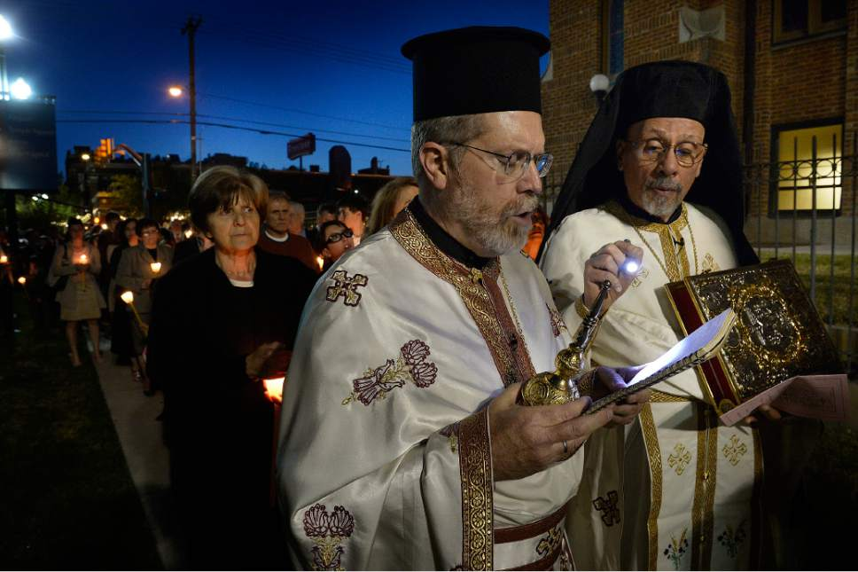 Scott Sommerdorf      The Salt Lake Tribune Rev. Matthew Gilbert, left, chants during the Lamentation of the Tomb procession in April 2015 at Holy Trinity Greek Orthodox Cathedral as Father Luke Kontgis holds a flashlight. Members of the Greek Orthodox Church of Greater Salt Lake's Holy Trinity Cathedral and Prophet Elias Church are mourning a diagnosis of late-stage bone cancer for their senior priest, Rev. Gilbert.