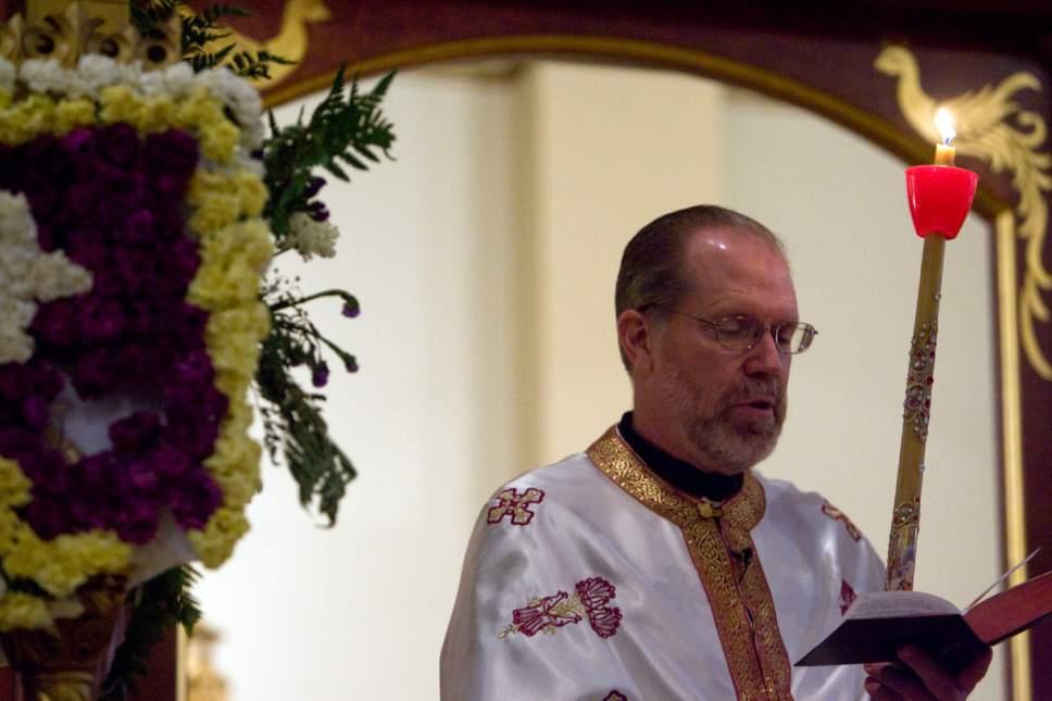    Tribune file photo  Father Matthew Gilbert of the Greek Orthodox Church.