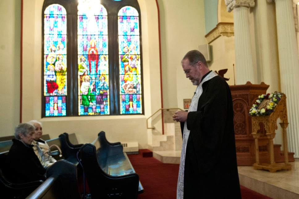 Chris Detrick     The Salt Lake Tribune Father Matthew Gilbert leads a prayer service at the Holy Trinity Greek Orthodox Cathedral for victims and all those affected by the Boston marathon bombing Tuesday April 16, 2013.