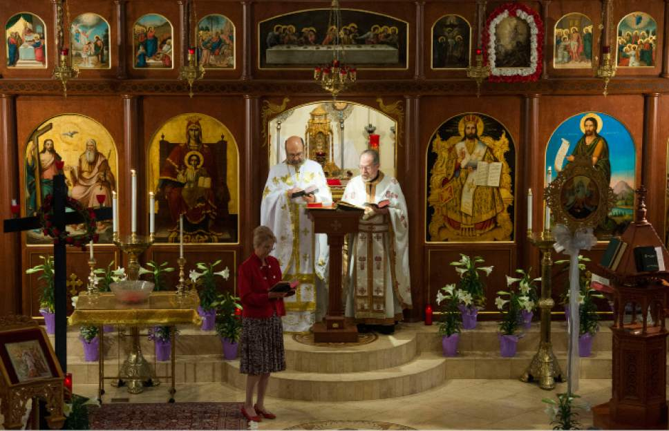 Steve Griffin     The Salt Lake Tribune  Fr. Elias Koucos and Fr. Matthew Gilbert preside over Easter Sunday service for the Greek Orthodox Church at the Holy Trinity Greek Orthodox Cathedral in Salt Lake City, Sunday, April 12, 2015.