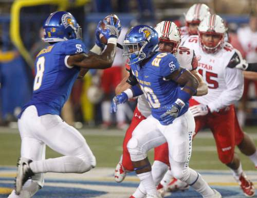 San Jose State wide receiver Rashead Johnson takes a toss from running back Malik Roberson as Utah linebacker Cody Barton chases, during the first half of an NCAA college football game Saturday, Sept. 17, 2016, in San Jose, Calif. (AP Photo/Mathew Sumner)