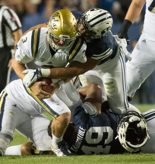 Rick Egan  |  The Salt Lake Tribune  Brigham Young Cougars linebacker Harvey Langi (21) defensive lineman Moses Kaumatule (49) team up to sack UCLA Bruins quarterback Josh Rosen (3), in football action, BYU vs, UCLA, at Lavell Edwards Stadium, Saturday, September 17, 2016.