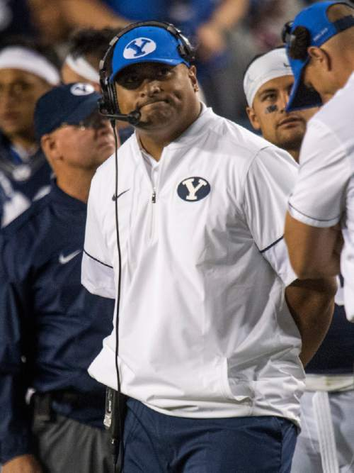 Rick Egan  |  The Salt Lake Tribune  Brigham Young head coach Kalani Sitake  checks out the scoreboard, as the Cougars trail UCLA, in football action, BYU vs, UCLA, at Lavell Edwards Stadium, Saturday, September 17, 2016.