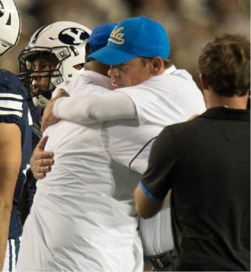 Rick Egan  |  The Salt Lake Tribune  Brigham Young Cougars head coach Kalani Sitake hugs UCLA Bruins head coach Jim Mora, after BYU lost to UCLA 14-17, at Lavell Edwards Stadium, Saturday, September 17, 2016.