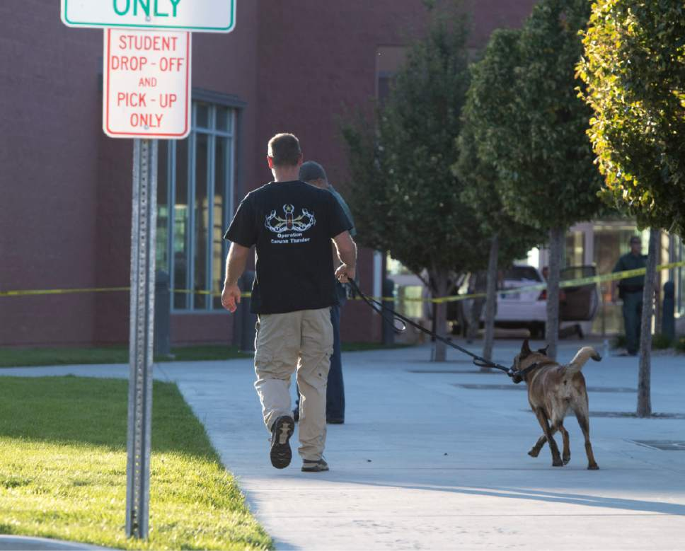 Rick Egan  |  The Salt Lake Tribune  A police dog checks out the school grounds at Eagle Valley Elementary School in Eagle Mountain. The school was evacuated after a masked man entered the school on Monday, Sept. 19, 2016.