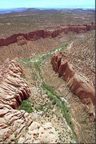 FILE - This May 30, 1997, file photo, shows the varied terrain of Grand Staircase-Escalante National Monument near Boulder, Utah. As Utah waits to see if President Barack Obama will designate a new national monument in the state, the 20th anniversary of the Grand Staircase Escalante-National Monument rekindled memories of an event that ignited simmering western frustrations about federal ownership of public land. (AP Photo/Douglas C. Pizac, File)
