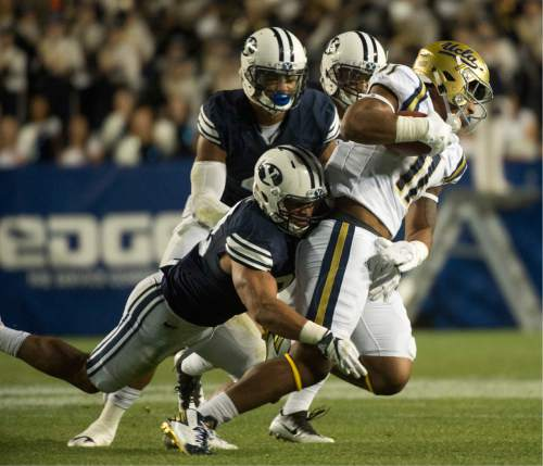 Rick Egan  |  The Salt Lake Tribune  Brigham Young Cougars linebacker Butch Pau'u (38) brings down UCLA Bruins tight end Nate Iese (11), in football action, BYU vs, UCLA, at Lavell Edwards Stadium, Saturday, September 17, 2016.