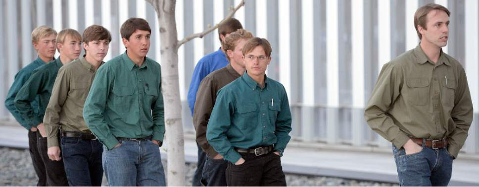 Al Hartmann  |  The Salt Lake Tribune  Dalton Wall Jeffs, right, son of FLDS Bishop Lyle Jeffs, leads a procession of FLDS men and women  to his father's detention status hearing Wednesday April 6 at the Federal Courthouse in Salt Lake City.