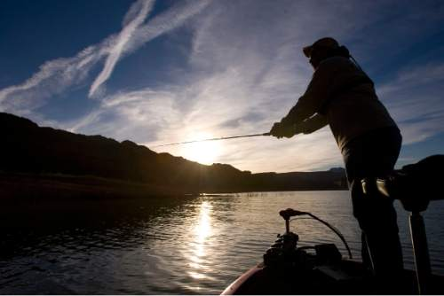 Al Hartmann  |  Tribune file photo George Sommer, chairman of the Utah Blue Ribbon Advisory Council, fishes in Lake Powell's Good Hope Bay as the sun sets in March 2015. The proposed Lake Powell Pipeline would pump Colorado River water from the lake to St. George.