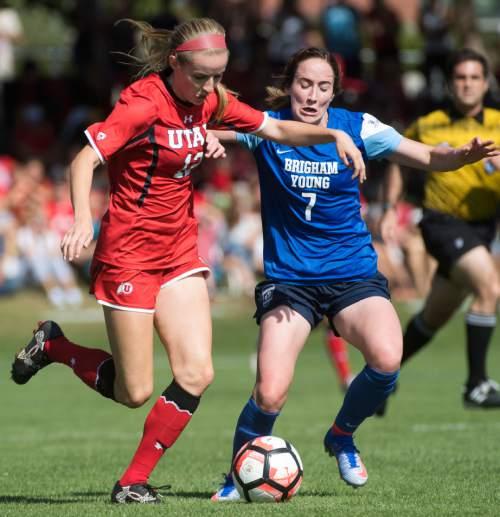 Rick Egan  |  The Salt Lake Tribune  Holly Daugirda (12) Utah, goes for the ball along with Michele Vasconcelos (7) BYU, in soccer action, BYU vs. Utah, at the Ute soccer field, Monday, September 5, 2016.