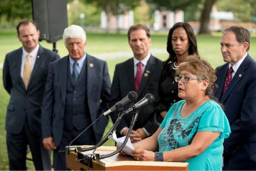 From left, Sen. Mike Lee, R-Utah, Rep. Rob Bishop, R-Utah, Rep. Chris Stewart, R-Utah, Rep. Mia Love, R-Utah, and Utah Gov. Gary Herbert, listens as Utah resident and Navajo Susie Philemon, bottom right, becomes emotional as she expresses her opposition to the proposed Bears Ears National Monument designation in southeast Utah, Wednesday, Sept. 21, 2016, on Capitol Hill in Washington. (AP Photo/Andrew Harnik)