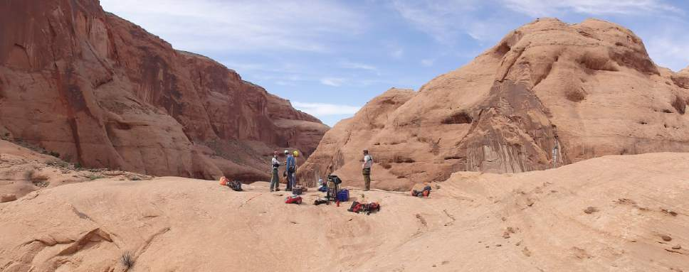 Photo courtesy of Jeff Moore  University of Utah geologists, pictured here at Rainbow Bridge, are studying the vibrational properties of Utah's natural bridges and arches. In a study published Wednesday, Sept. 21, 2016, they characterize various ways this iconic geological feature resonates in response to different disturbances.