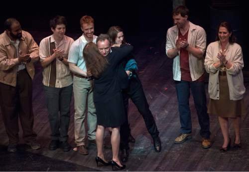 """Rick Egan     The Salt Lake Tribune  Sting hugs Karen Azenberg, director of """"The Last Ship,"""" on stage during the curtain call, at Pioneer Theatre Company, Thursday, Sept. 22, 2016."""