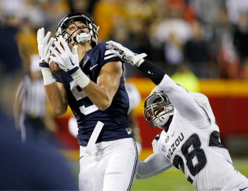 BYU wide receiver Nick Kurtz, left, catches a 38-yard pass as Missouri defensive back Logan Cheadle, right, defends in the first half of a college football game at Arrowhead Stadium, Saturday, Nov. 14, 2015, in Kansas City, Mo. (AP Photo/Colin E. Braley)
