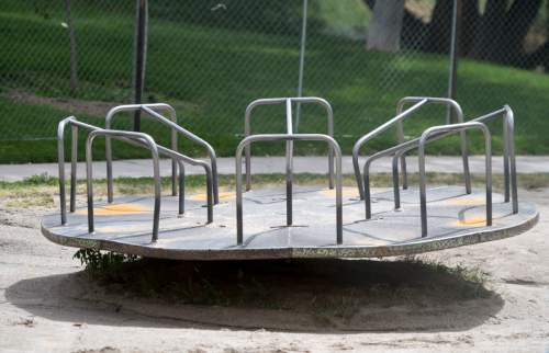 Rick Egan     The Salt Lake Tribune  There is a plan to renovate the Lindsey Gardens playground and get rid of the classic metal merry-go-round. Residents are angry & are organizing to save it. Wednesday, September 14, 2016.
