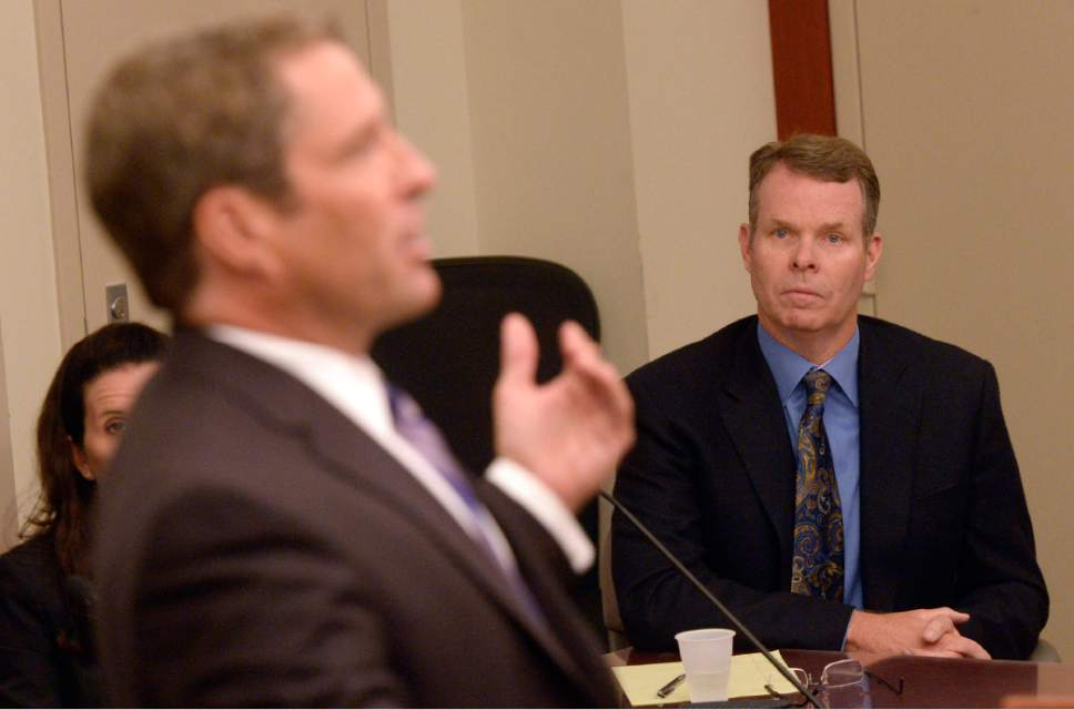 Al Hartmann  |  The Salt Lake Tribune  Attorney Scott Williams, left, argues that charges against his client, John Swallow, right, should be dismissed during a hearing on Wednesday, July 13, 2016.