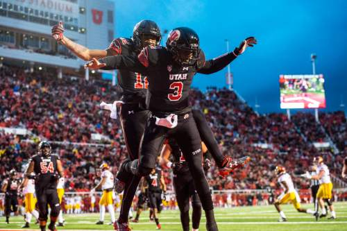 Chris Detrick  |  The Salt Lake Tribune Utah Utes quarterback Troy Williams (3) and Utah Utes wide receiver Tim Patrick (12) celebrate after Williams' touchdown during the first half of the game at Rice-Eccles Stadium Friday September 23, 2016.