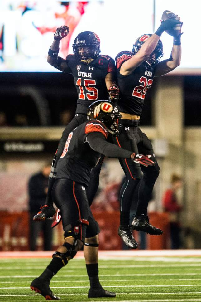 Chris Detrick  |  The Salt Lake Tribune Utah Utes defensive back Dominique Hatfield (15) and Utah Utes defensive back Chase Hansen (22) celebrate after recovering a fumble during the first half of the game at Rice-Eccles Stadium Friday September 23, 2016.